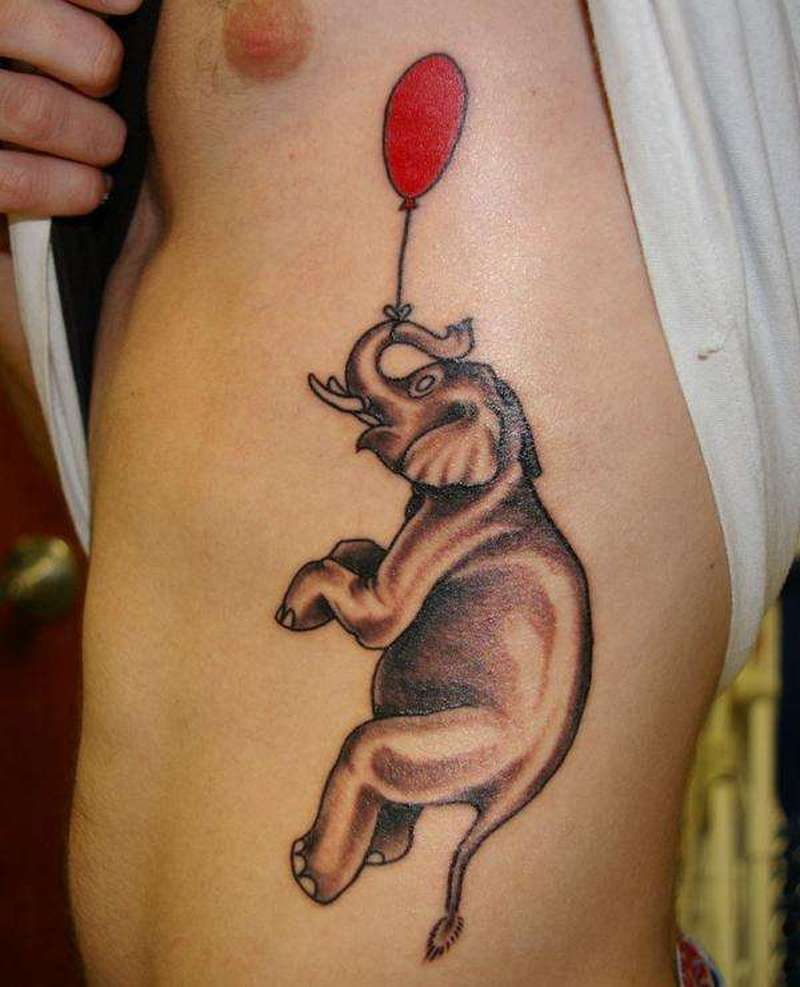 Elephant with red ballon tattoo on ribs