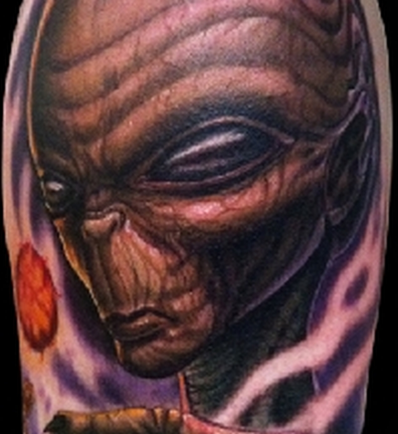 Evil and ugly alien tattoo design