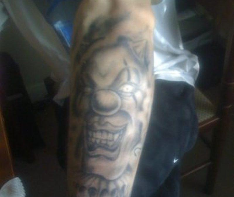 Evil clown tattoo on forearm 3