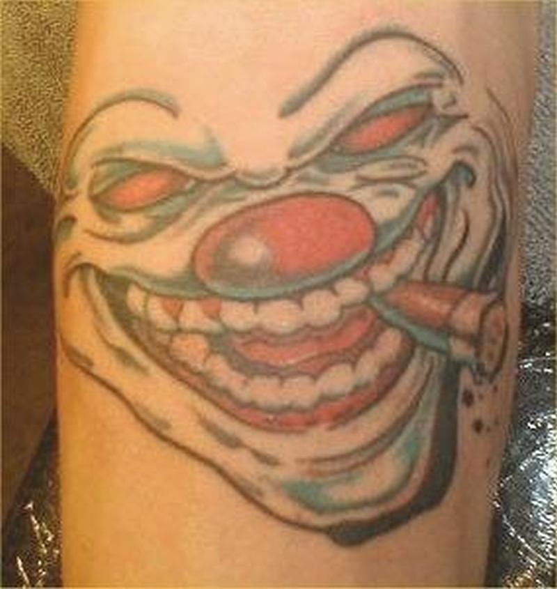 Evil clown with cigar tattoo
