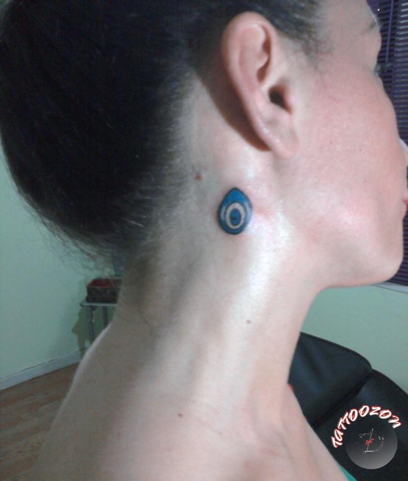 Evil eye tattoo on neck