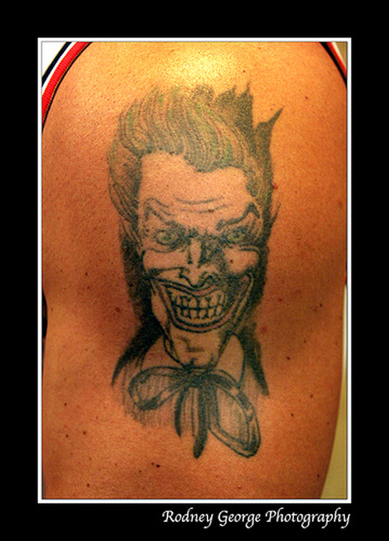 Evil joker tattoo photo 2
