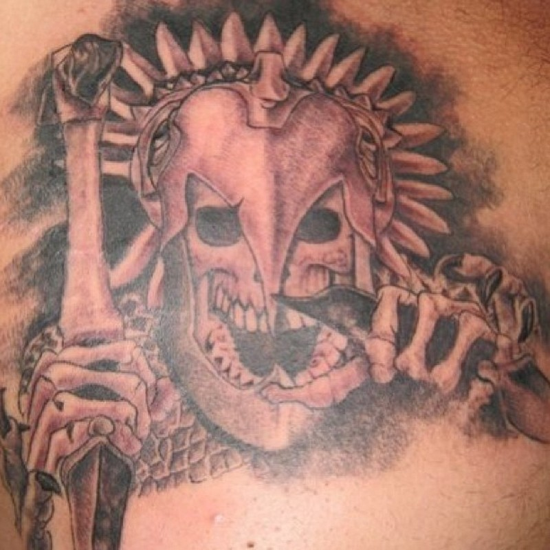 Evil skeleton in iron mask aztec tattoo
