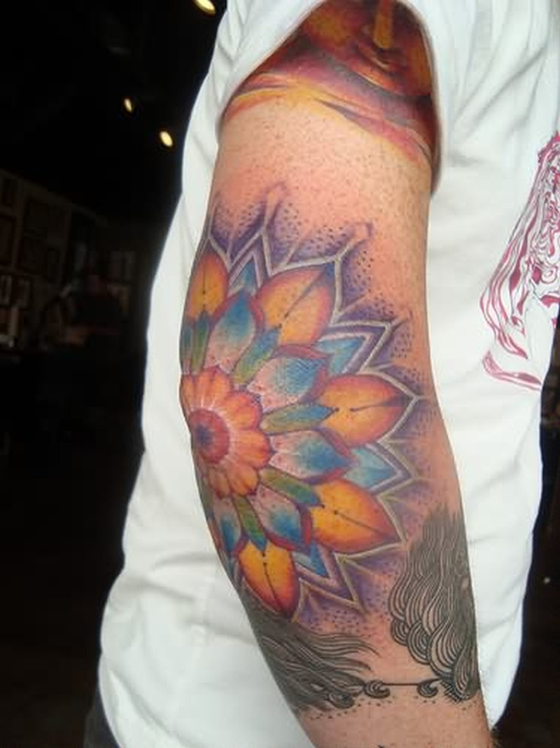 Extreme flower tattoo on elbow