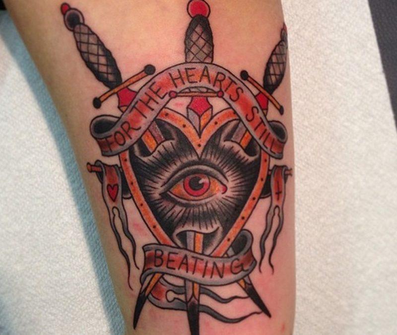 Eye n three traditional dagger tattoo with inscriptions