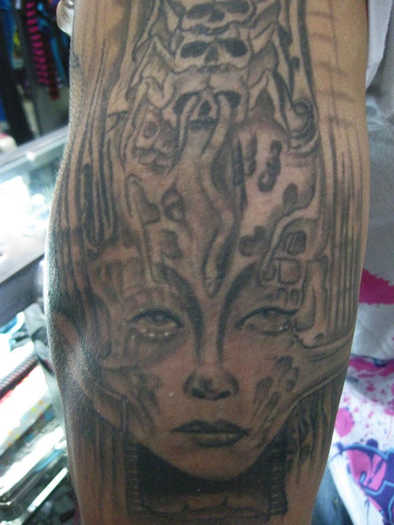 Fabulous alien woman tattoo design