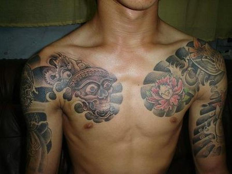 Fabulous asian tattoo on chest arm