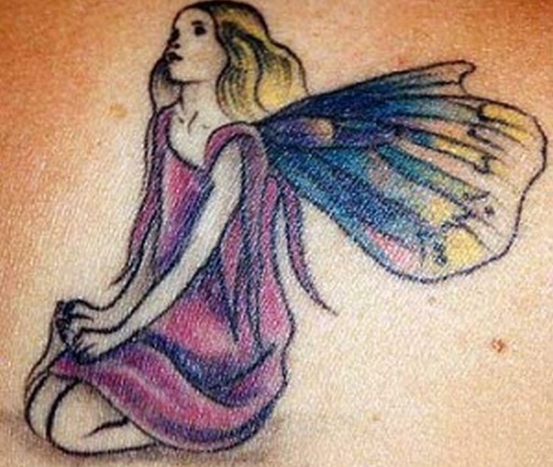 Fairy sitting fantasy tattoo design