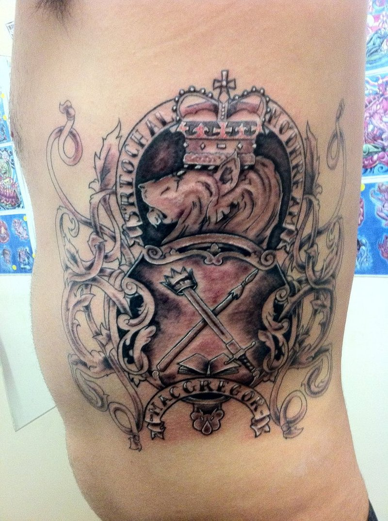 Family coat of arms tattoo on ribs for men