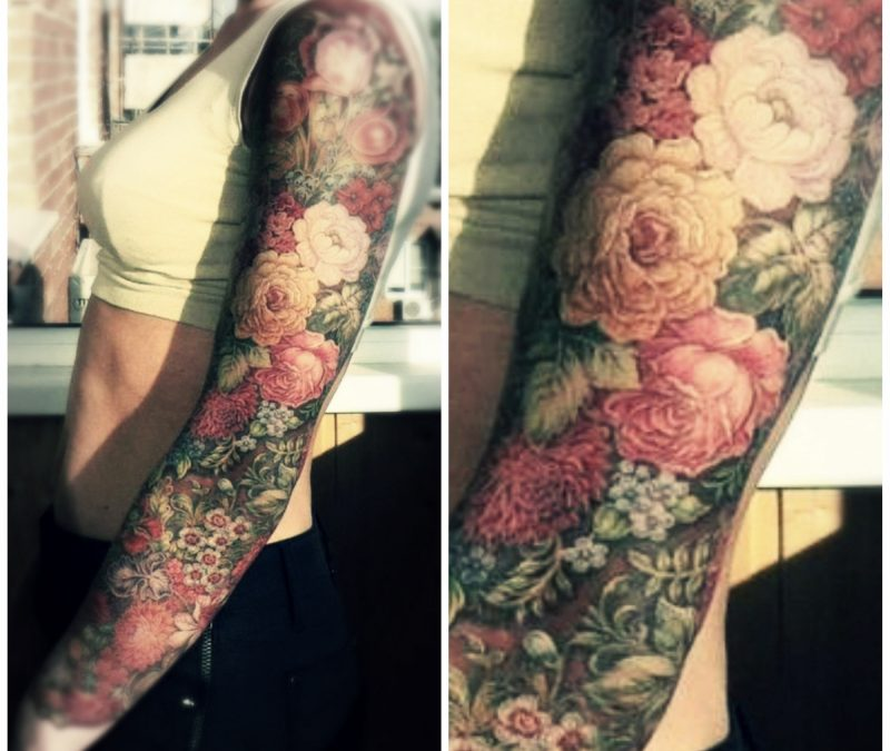 Fancy floral tattoo on sleeve
