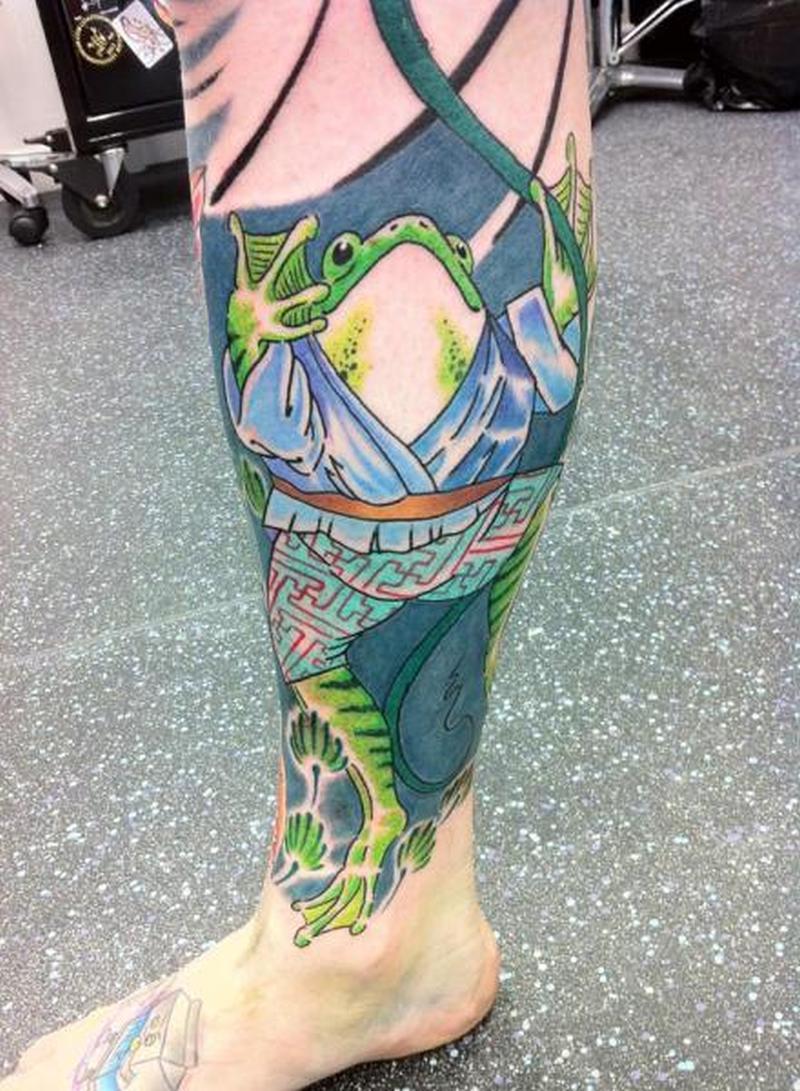 Fantasy japanese frog on calf tattoo