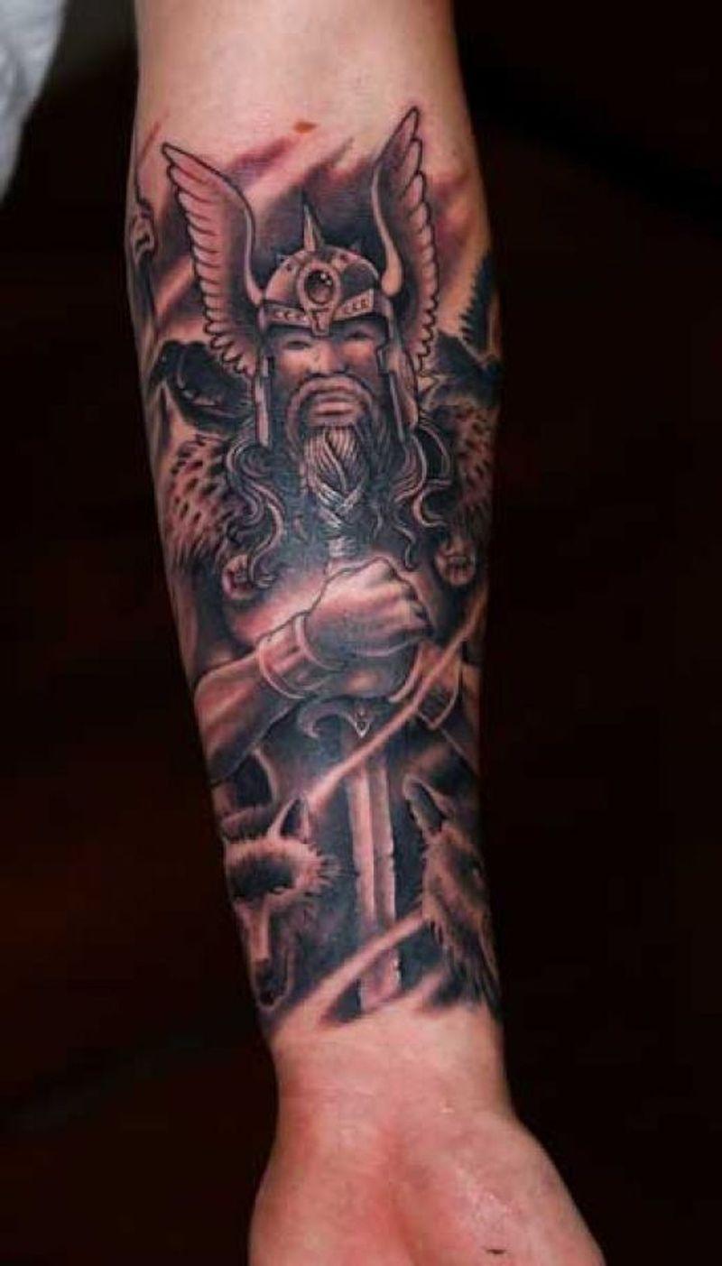 Fantasy on lower arm tattoo