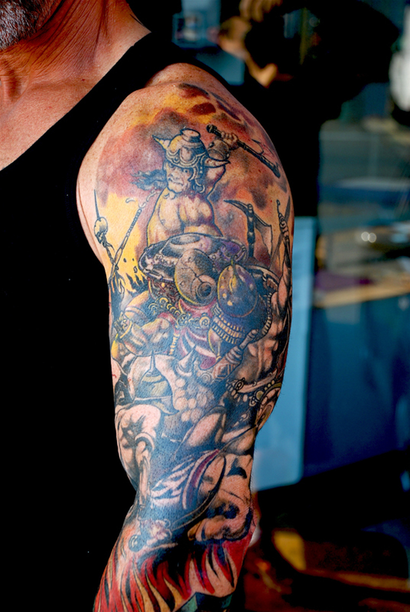 Fantasy tattoo on sleeve for men