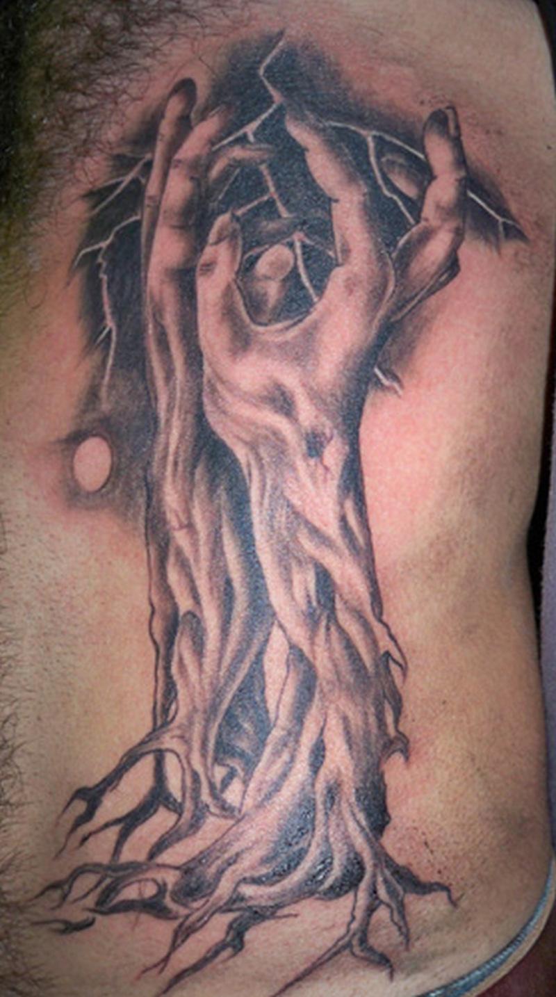 Fantasy tree tattoo on ribs for men