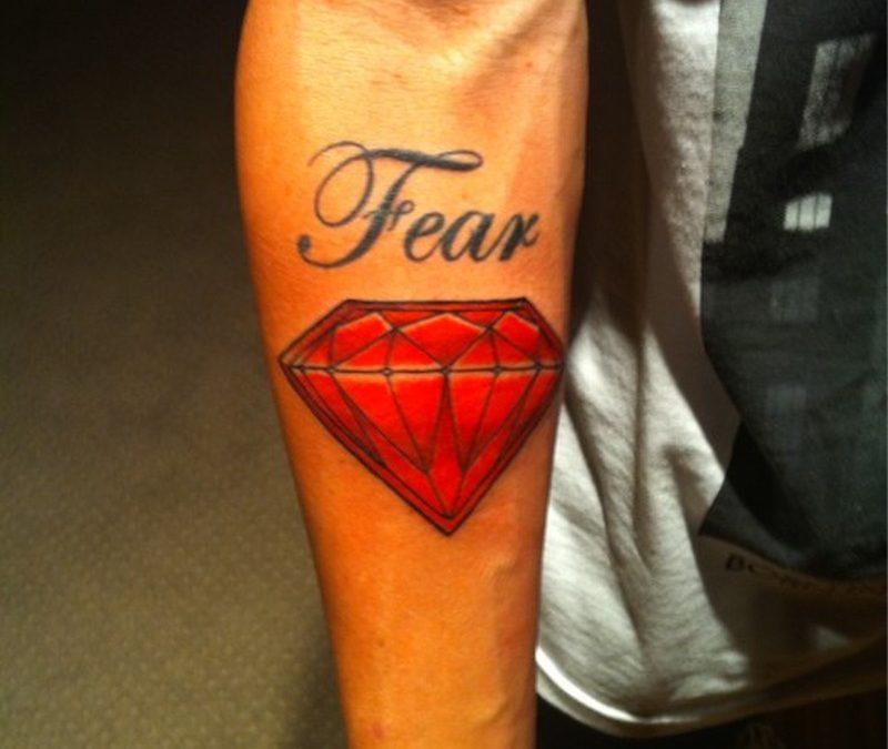 Fear diamond tattoo on forearm