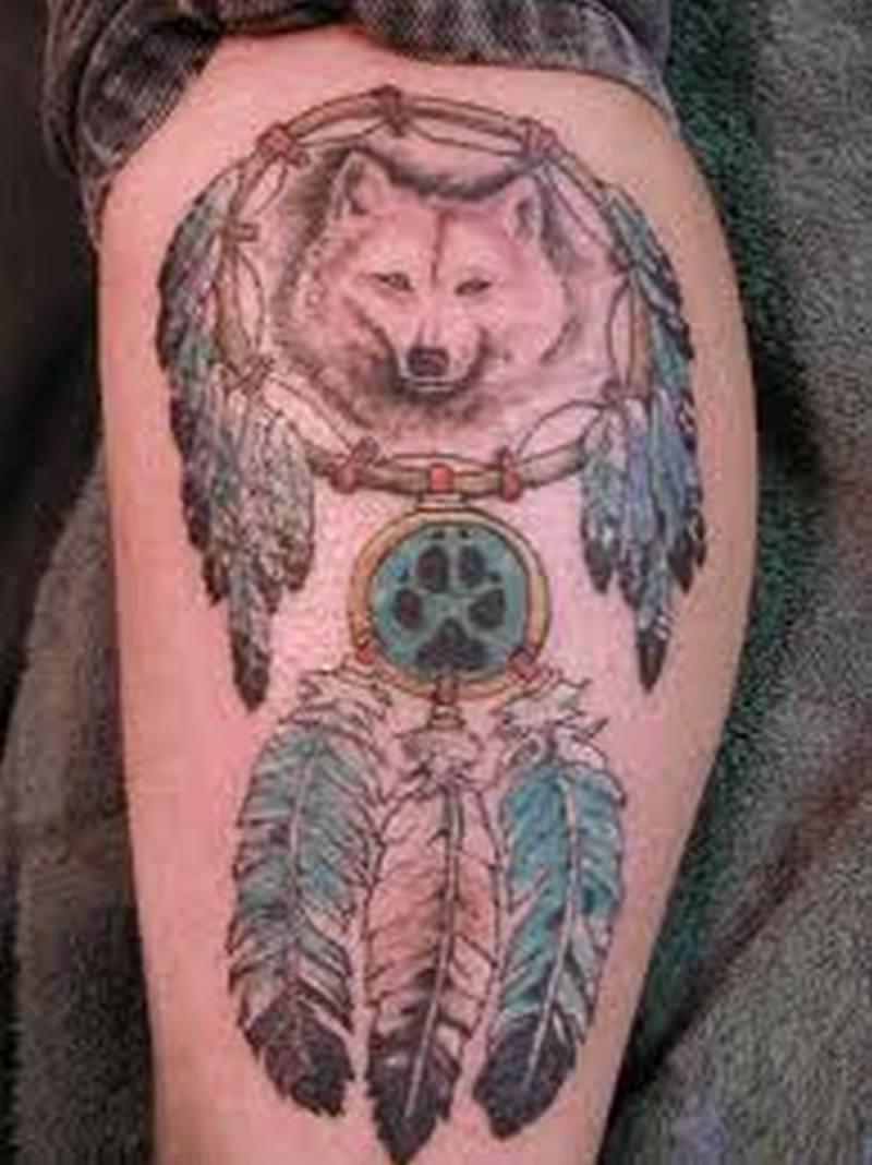Feather and bear tattoo