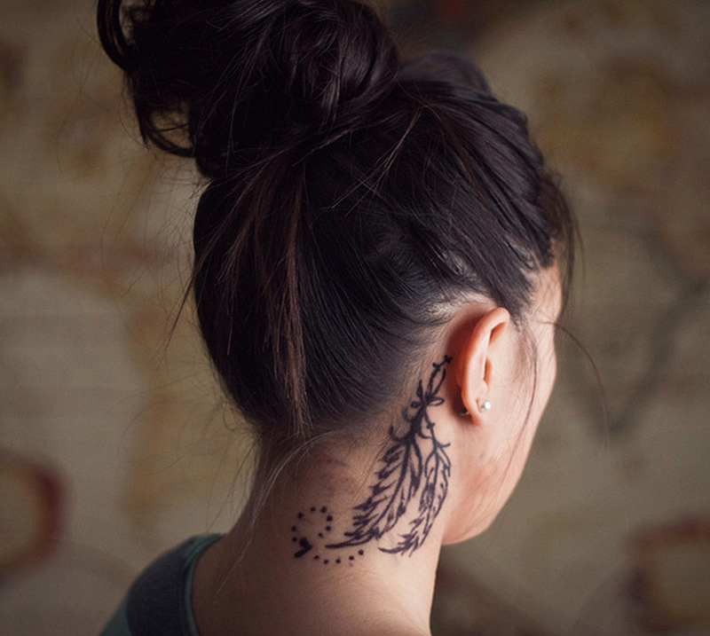 Feather tattoo designs behind ear