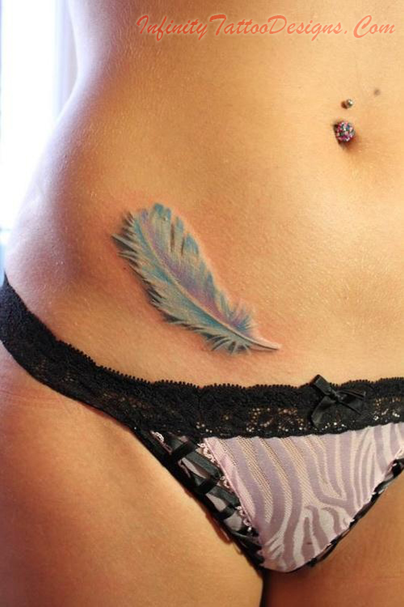 Feather tattoo on hip
