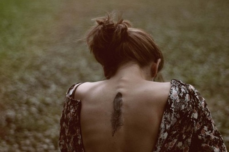 d879fa658803f Feather tattoo on upper back for women - Tattoos Book - 65.000 ...