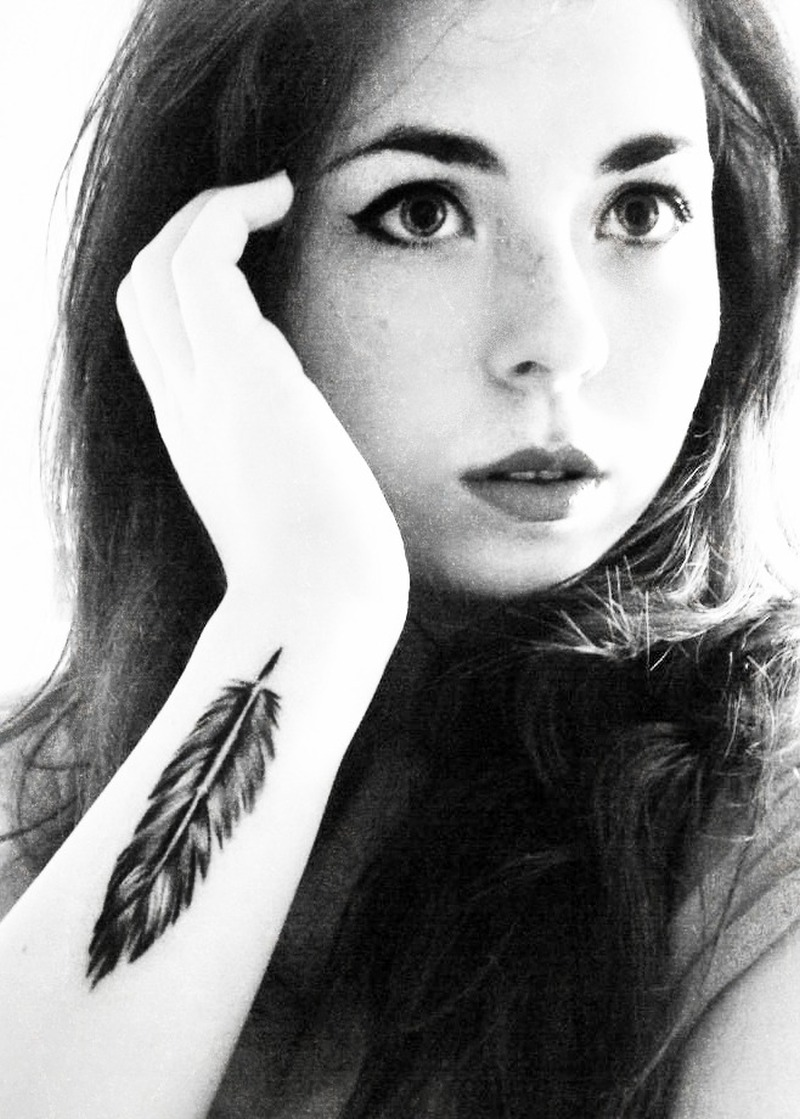 Feather tattoo on wrist 2