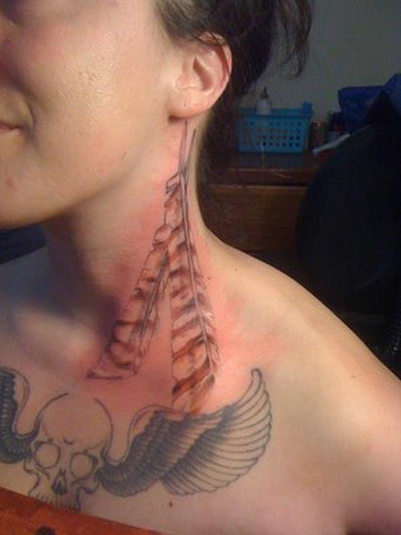 Feathers tattoo on neck