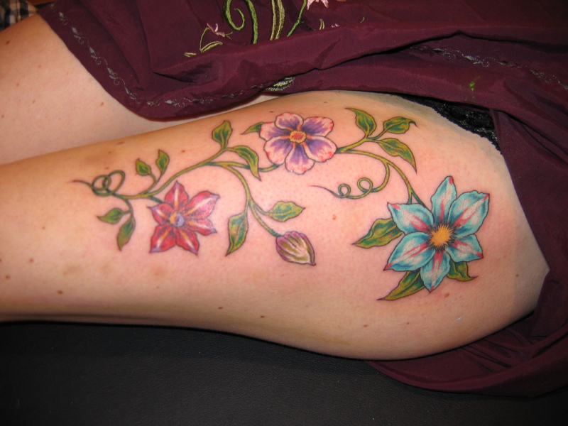 Hip and thigh tattoo designs