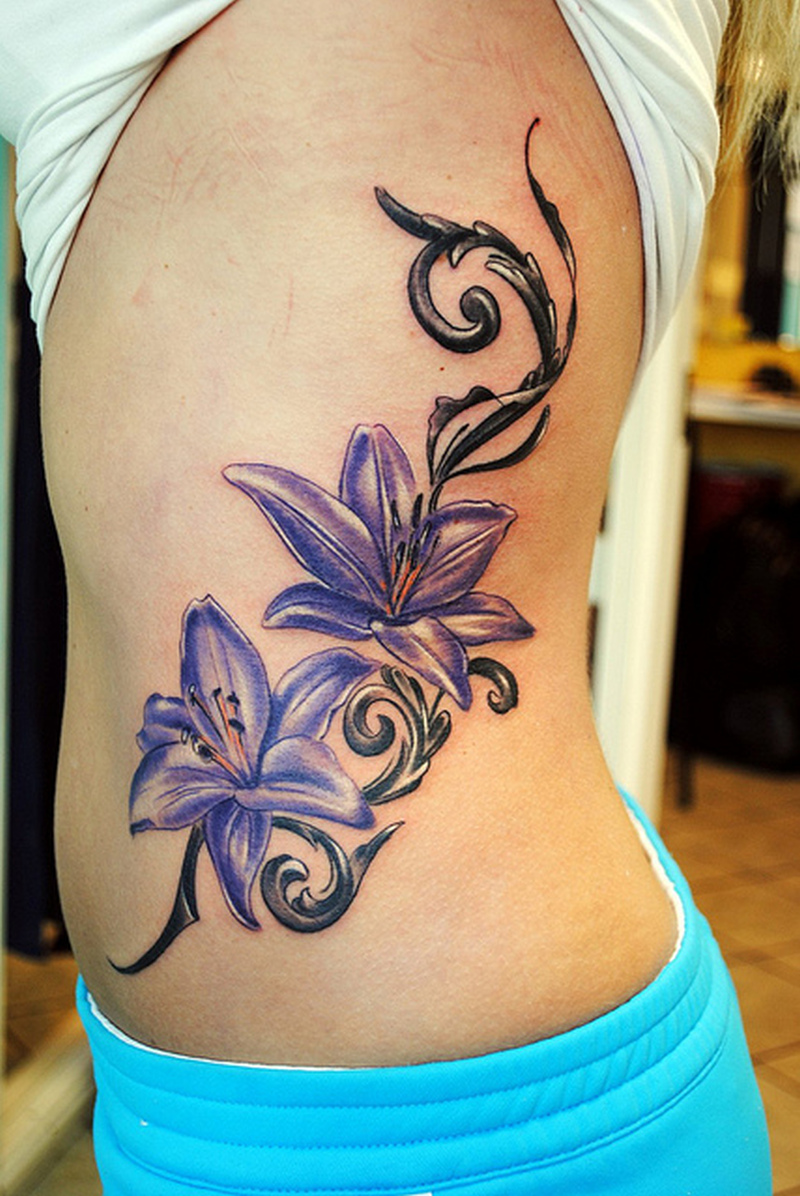 Feminine lily flowers tattoo on rib side tattoos book 65000 feminine lily flowers tattoo on rib side izmirmasajfo
