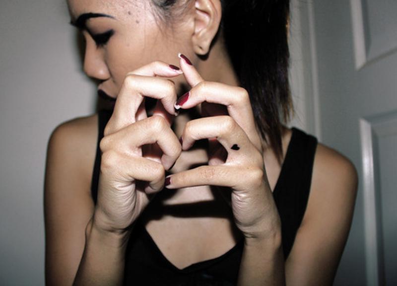Finger heart tattoo for girls