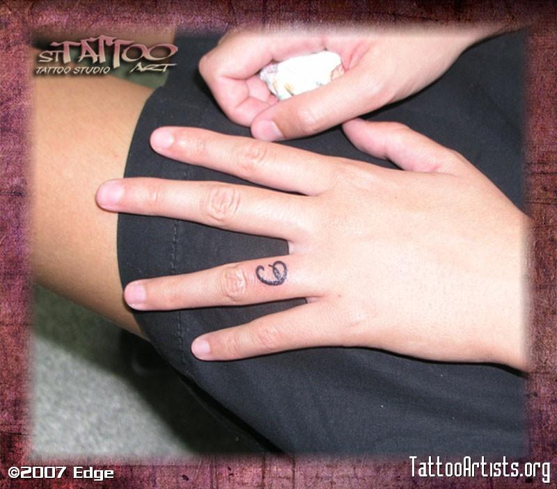 Finger letter tattoo design