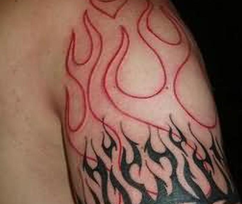 Fire n flame tattoo on upper arm