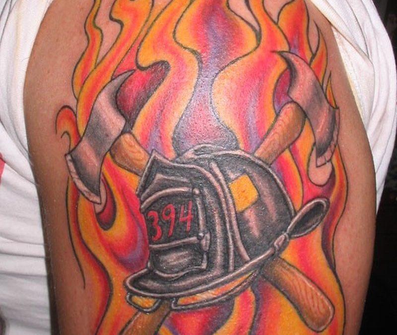 Firefighter helmet n fire tattoo on shoulder