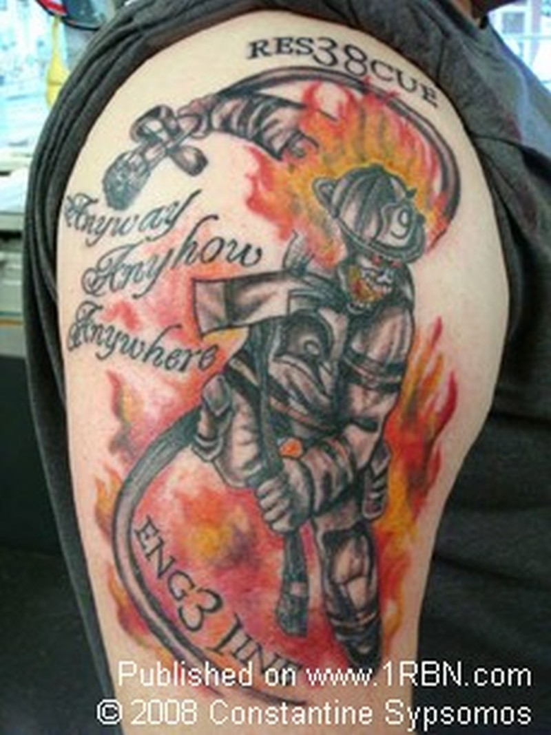 Firefighter in action on shoulder tattoo