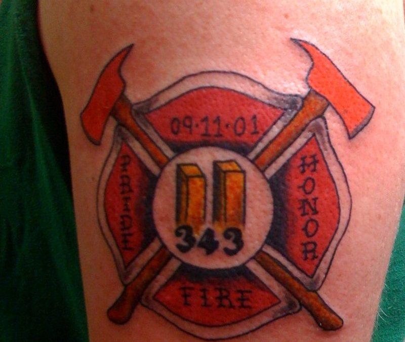 Firefighter logo tattoo on biceps 2