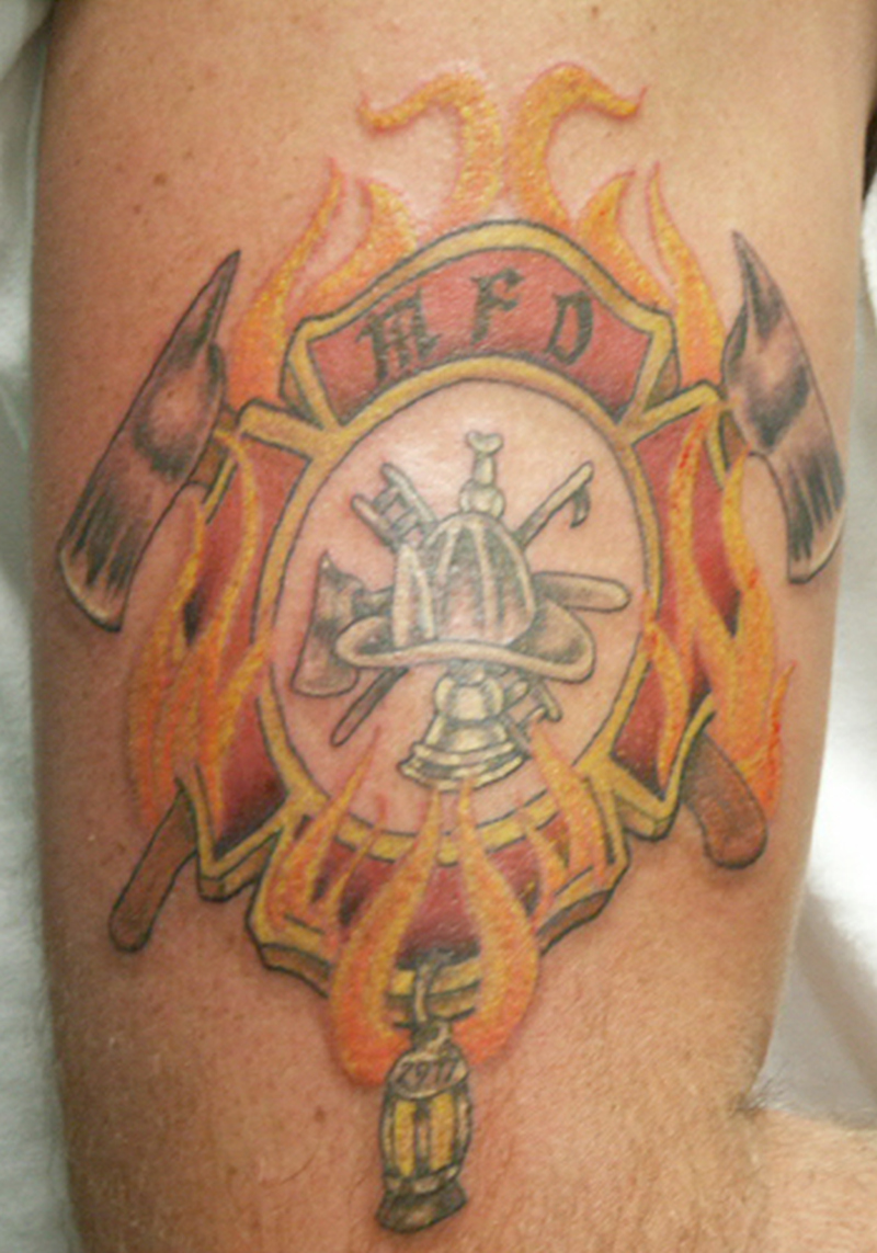 Firefighter logo tattoo on biceps