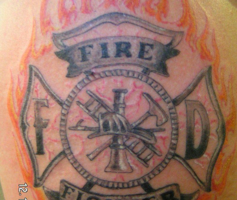 Firefighter maltese cross tattoo on shoulder