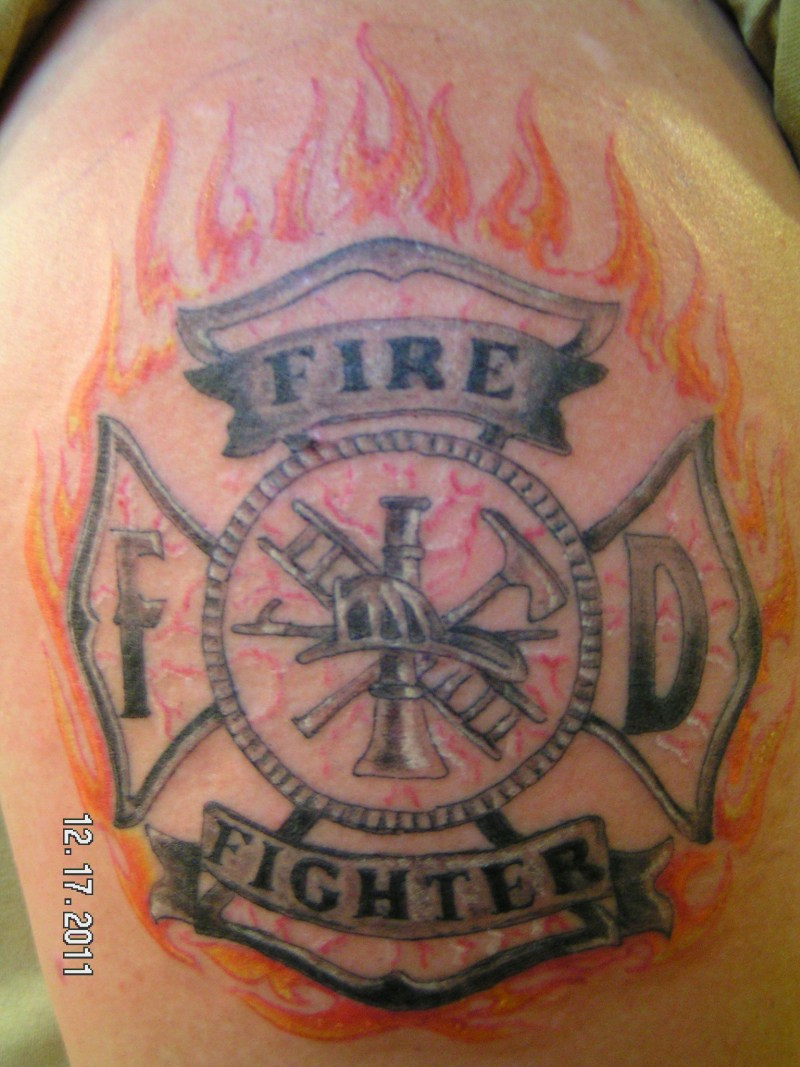 Firefighter maltese cross tattoo on shoulder