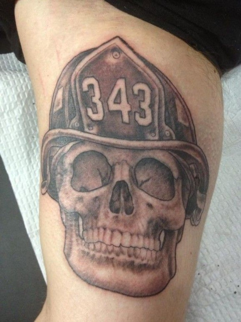 Firefighter memorial tattoo on arm