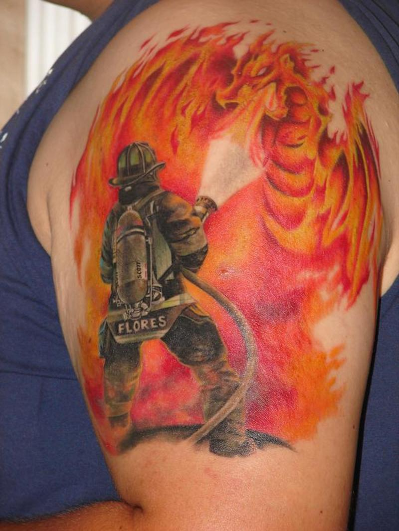 Firefighter n flamming dragon on upper arm tattoo