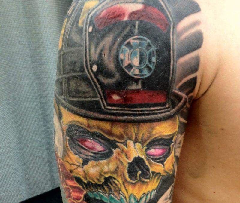 Firefighter skull tattoo on shoulder