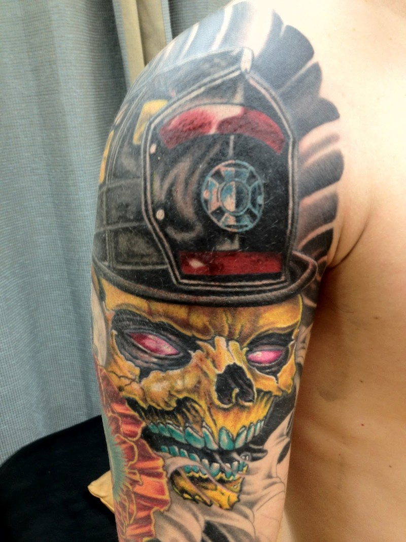 Firefighter skull tattoo on shoulder