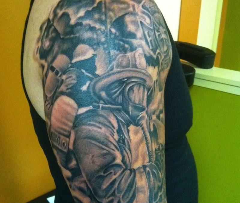 Firefighter tattoo on half sleeve