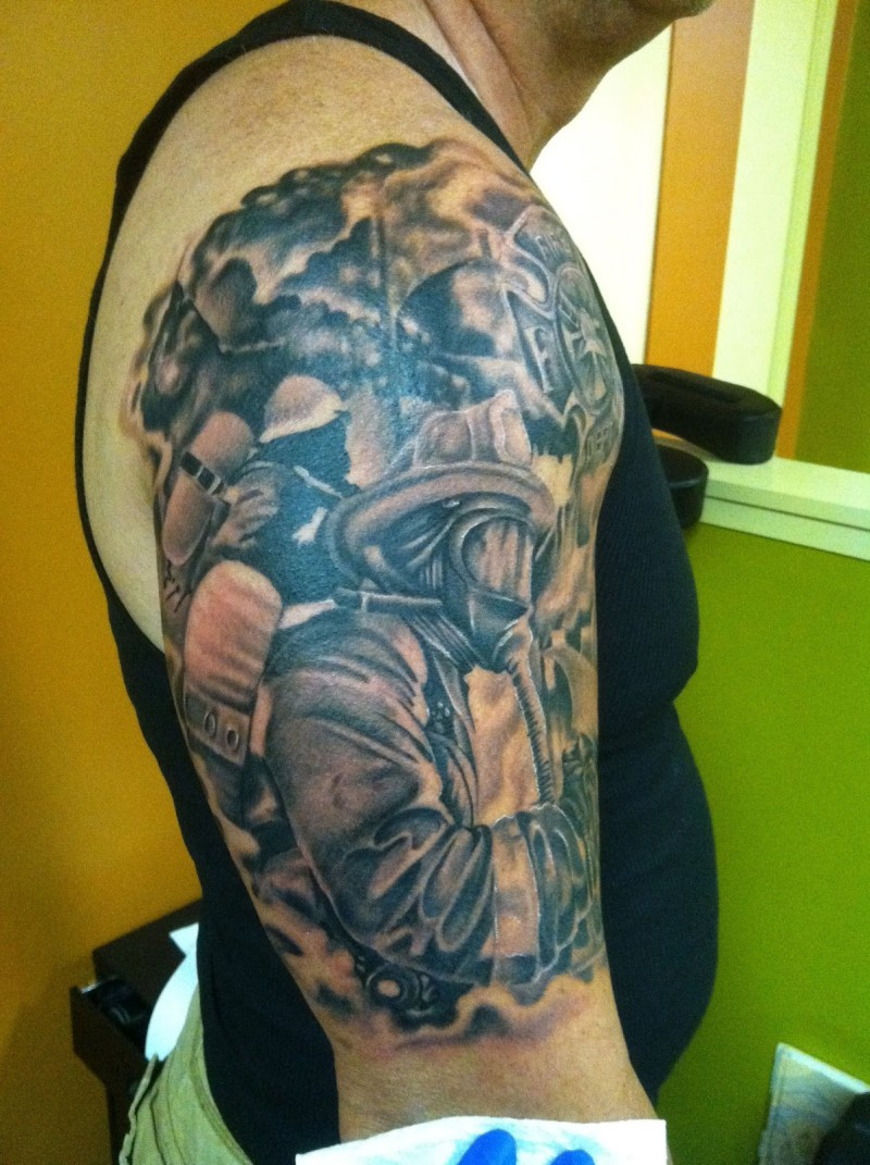 Firefighter tattoo on half sleeve