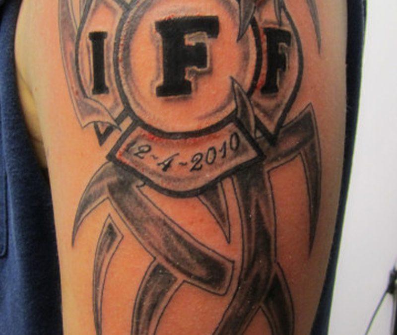 Firefighter tribal tattoo design on shoulder