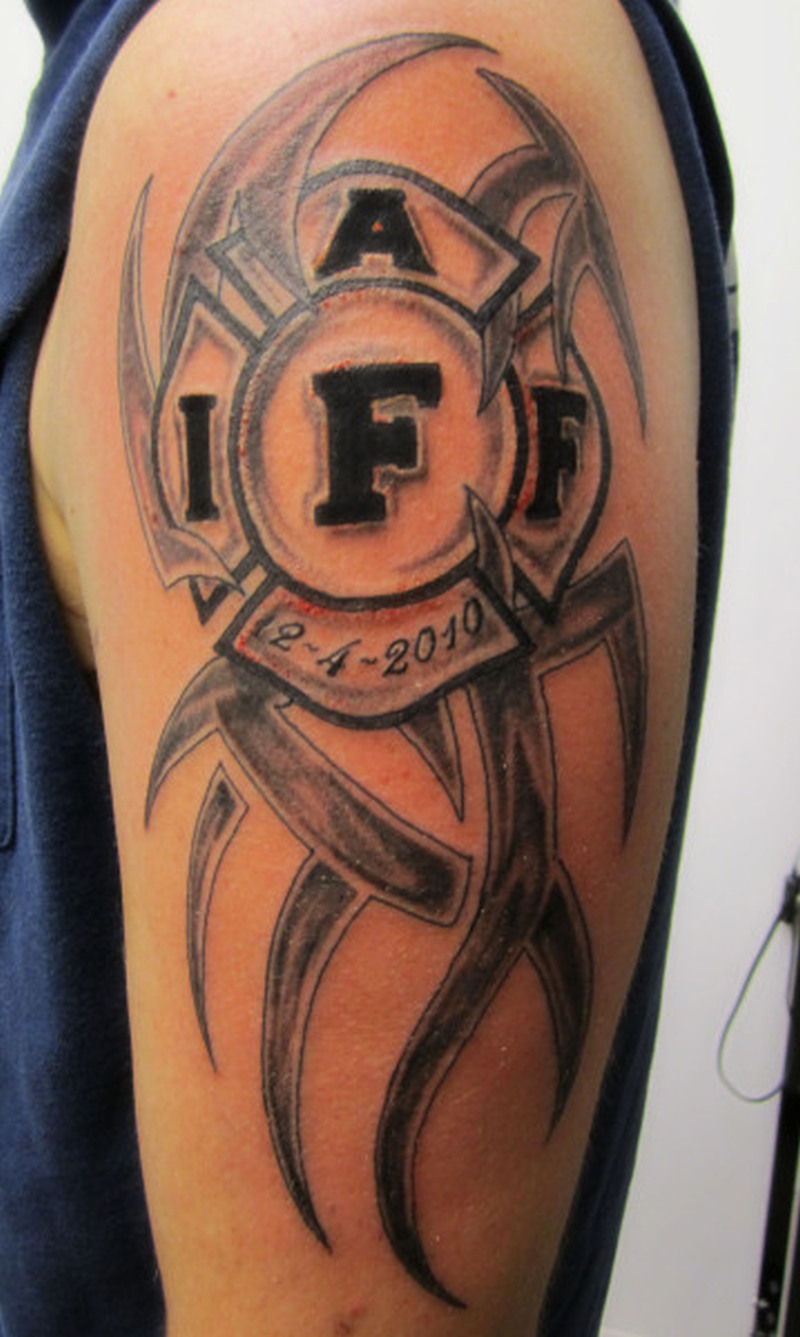 Firefighter tribal tattoo design on shoulder
