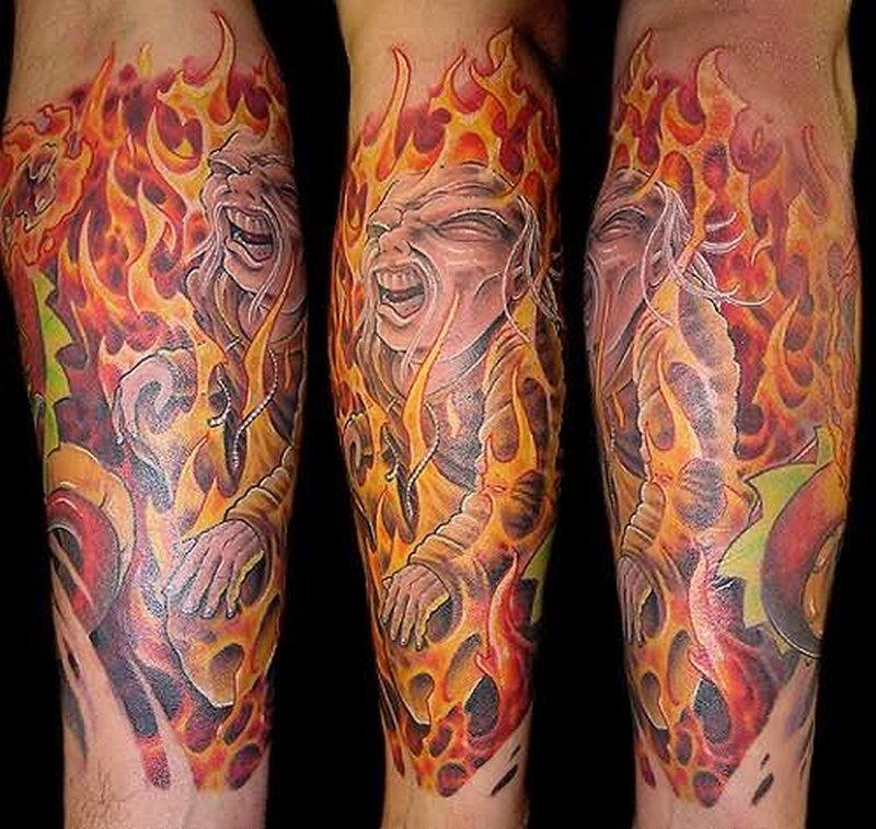 Fish flame tattoo on leg
