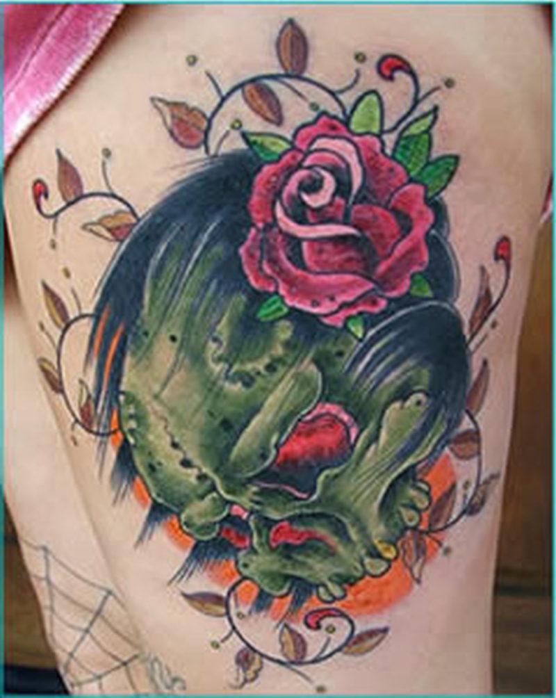 Fish skull tattoo on leg