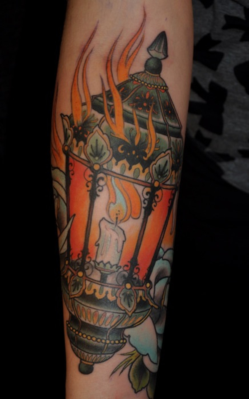 Flaming candle lamp tattoo design