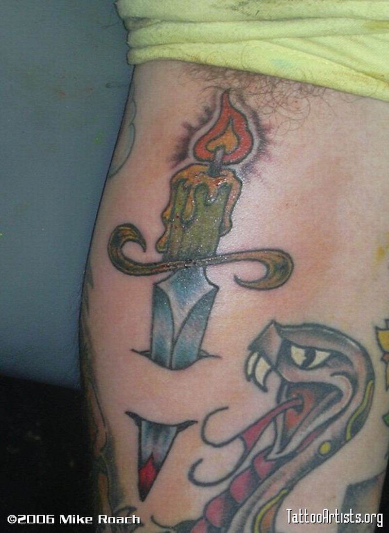 Flaming candle with snake tattoo