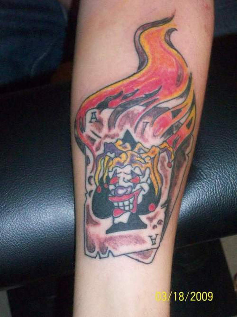 Flaming joker card tattoo design tattoos book for Card tattoo designs