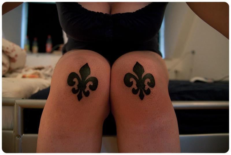 Fleur de lis on both knees tattoo